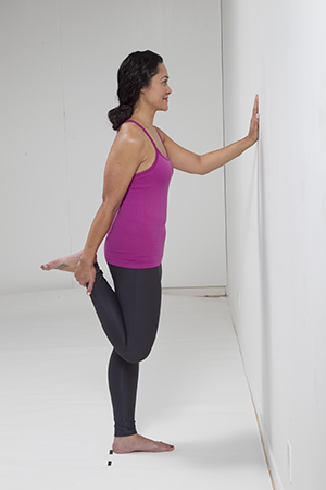 Person doing quadriceps stretch standing exercise.