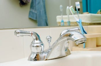 kitchen sink with toothbrushes