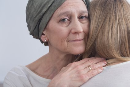 woman offering support to another woman with cancer