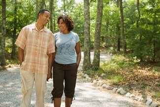 African American couple taking a walk in the woods