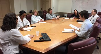 Aspen, Natalia Miles, Barb Olesko, Maureen Graham, Jenn Richman, Mark Oldham, Annalyn Gibson in PCLS conference room