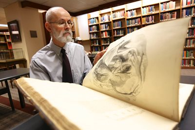 Chris Hoolihan with rare book