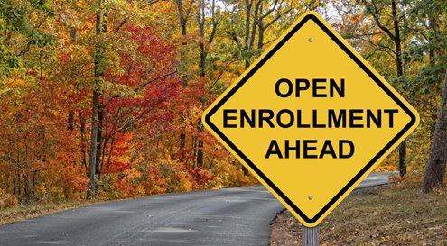 "Autumn road scene with sign saying ""Open enrollment ahead"""