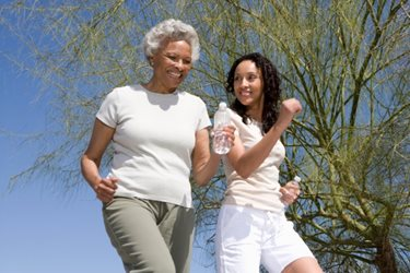 mother and daughter jogging outdoors in nice weather
