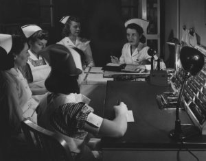 Class of 1944 nursing students with Nurse Mary Ruth Gill during morning report.