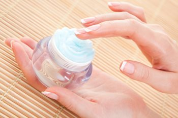 woman's hands with moisturizer