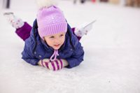 little girl fallen on ice while skating