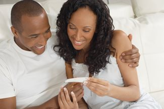couple checking pregnancy test results