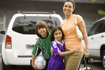 mom with kids near car going to soccer practice