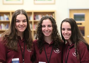 Triplets, Natalie, Julea and Mairin Farchione pose on their first day of volunteering for summer 2019.