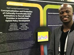 Jahron Marriott stands in front of his poster at the APHA Annual Meeting