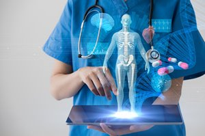 Research nurse holding tablet, graphic of medical technologies
