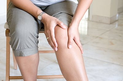 Woman with sore knee