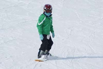 young person snowboarding