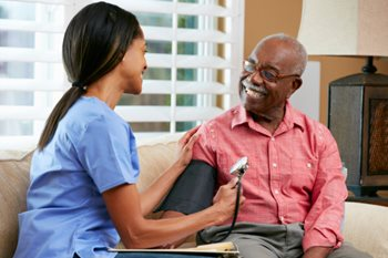 nurse taking man's blood pressure