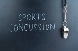 sports concussion written on chalkboard