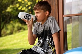 boy drinking out of water bottle