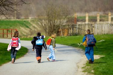 young children wearing backpacks