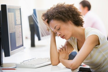 woman falling asleep at her computer