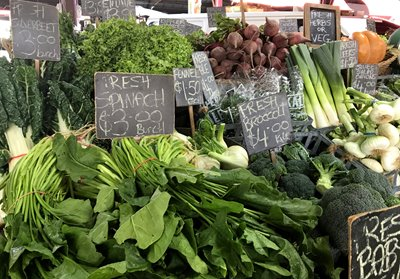 leafy greens for sale at a farmers' market