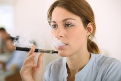 woman smoking e-cig