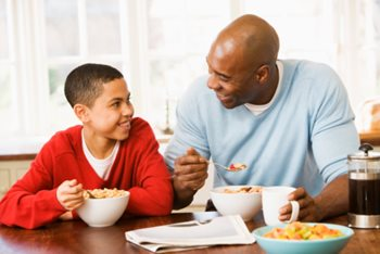 Father and son eating healthy breakfast