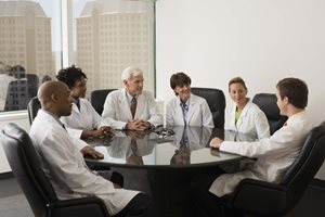 Doctors around a conference table