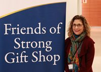 Luanne Crosby stands in front of the hospital gift shop on her first day at the helm.