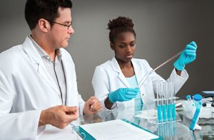 Young African American Female student with mentor in laboratory
