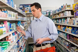 man shopping in drug store aisle