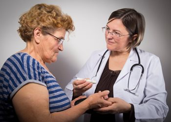 Doctor giving patient diabetes instructions