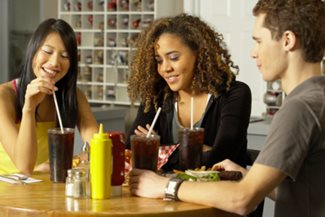 young people drinking soda in a restaurant