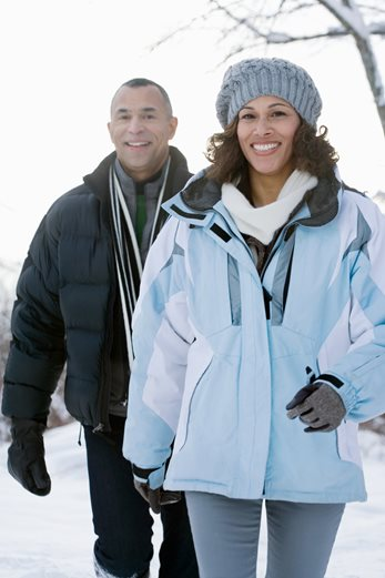 African-American couple walking outdoors in winter