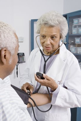 doctor taking a gentleman's blood pressure