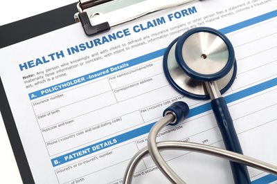 health insurance form with pen and stethoscope