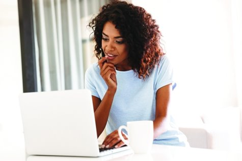 Young woman looking at laptop computer