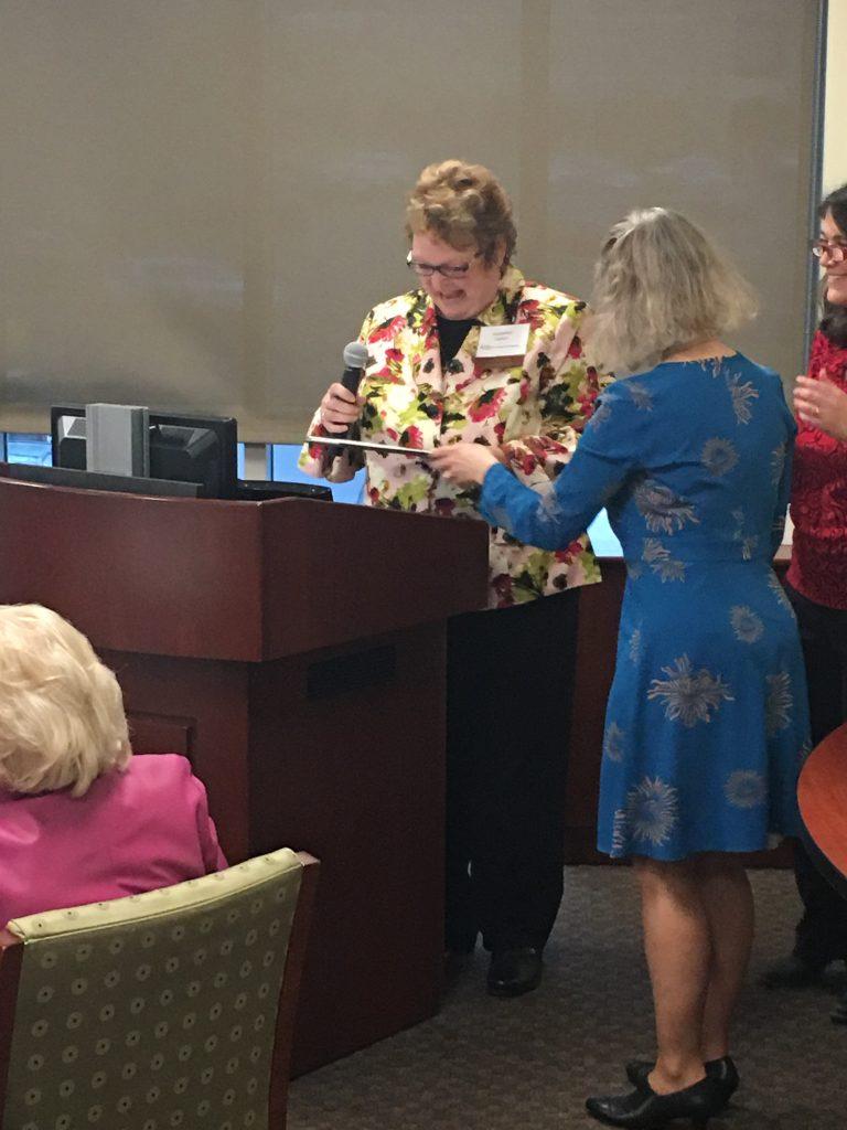 Jackie Coates receiving an award.