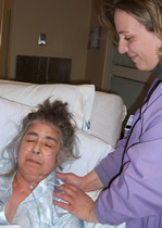 Massage therapist working with a patient