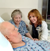 One of our NPs with a patient and his wife