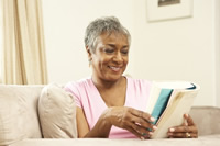 woman reading book post menopause