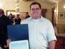Brian Palmer with Award