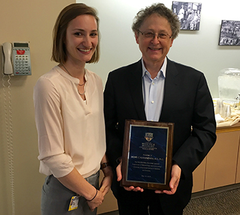 Photo of Dr. Michael Nussenzweig with award