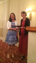 Elissa Wong being presented with the Newman Award