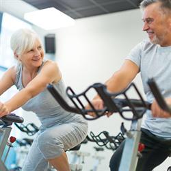 senior adults on exercise bikes