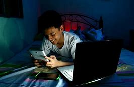 Boy with multiple screens